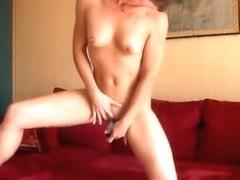 Hot brunette girl masturbates with a vibrator on the sofa