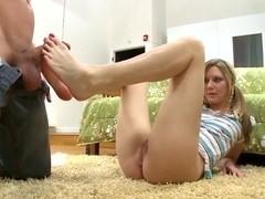 Kacey Jones' hands help her feet to stroke the bean