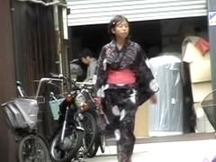 Cute Asian in a jukata has boob sharking on the street.