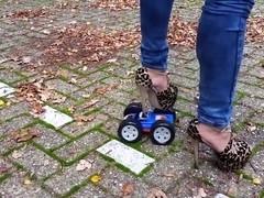 High heels crush toy car
