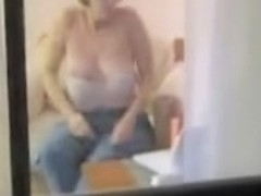 Naked mature woman voyeured masturbating through window