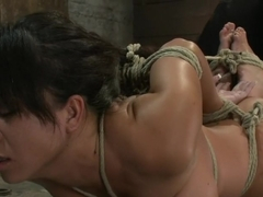 Sexy Hawaiian brutally hogtied suffering orgasm after orgasm until she is lying in her own squirt.