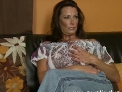 Sexy Milf Mimi Moore finger fucks her pussy