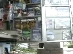 Newspaper stand upskirt video of a hot brunette