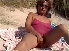 Mommy with Bushy Cookie Filmed Nude on the Public Beach
