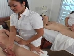Two professional masseurs Ashley Marie and Marquetta Jewel give a great cock massage