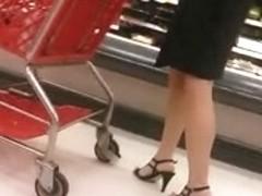 A peek up a professional looking brunette's skirt