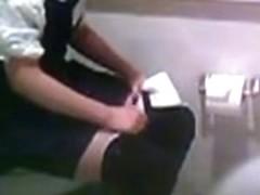 Asian girls pissing in a school toilet filmed on camera