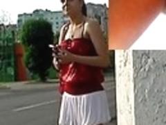 Glamorous brunette hair in street upskirt clip