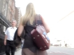 Street candid butt of luxurious blonde in sheer skirt
