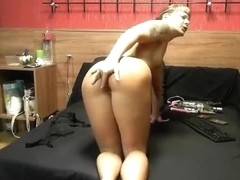 FitnessLady36 fucks herself on the bed
