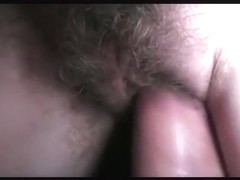 Playing with my gf's hairy pussy by sticking my cock in it and rubbing her clit with my dick