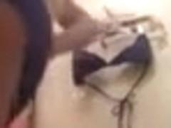 Amatur porn clip shows a hottie taking her clothes off