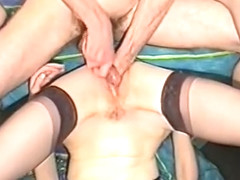 Milf in stockings fisted hard and jerking hubby's cock