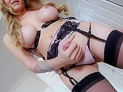 Hot blonde tranny with big breasts in lingerie pose